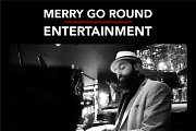 Pianist at Merry Go Round - The Smallville Hotel